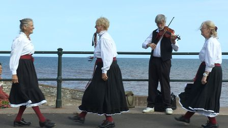 Three ladies and a fiddle from A Small Quiet English Town