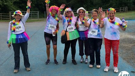 Hands in the air - a cheerful wave during the Rainbow Run