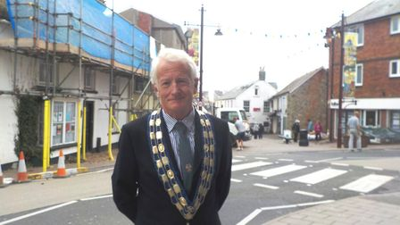 Peter Burrows outside one of the listed buildings in Queen Street that is getting a new thatch.