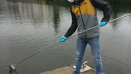 Dr Jorge Casado, lead researcher of the pesticide project, taking a sample from the River Exe