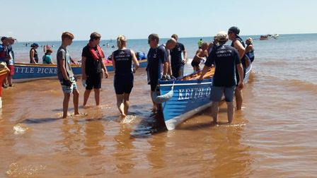 Sidmouth Gig Club Jurassic League Regatta. Both Sidmouth gigs and the juniors.