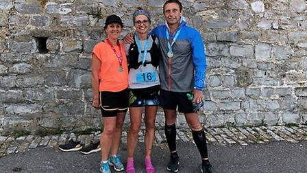 Sidmouth Running Club members Sarah Watkins (who did the 50km version) and Jessica Raynor and Danny