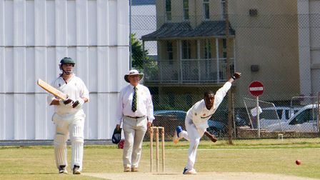 Aviwe Mgijima bowling for Sidmouth against a touring side called Free Foresters. Ref shsp 28 18TI 78