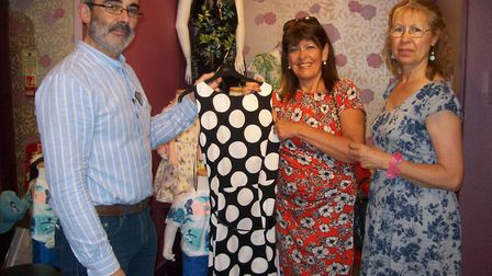 John Lourenco, manager of the M&Co shop in Sidmouth, shows one of the dresses to model Bev Raw and G