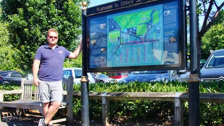 Matt Waite of Wall Art in Ottery showcases the new maps he has designed which promotes the town and