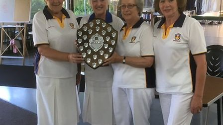Sidmouth bowlers Wendy Cox, Janice Quinn and Jill Bishop receiving the Budleigh Jubilee Trophy that