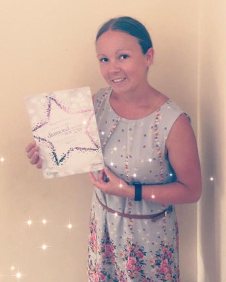 Clare Luke is named one of Sidmouth Slimming World's diamond members of the year after maitaining he