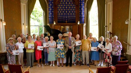 Dame Alison Carnwath presented certificates to those that donated money to repair a chandelier at Si