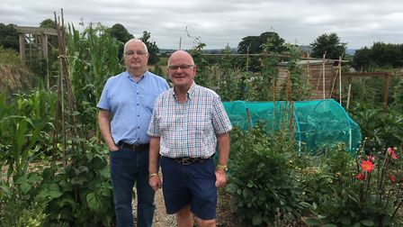 Councillors Ian Holmes and Glyn Dobson at the allotments in Ridgeway which they and gardeners have h