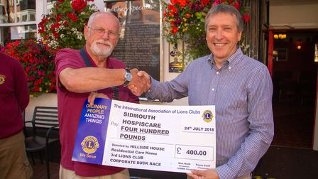 Lions Prersident Alex Blyth presents a cheque to Robert McIlwraith of Sidmouth Hospiscare. Ref shs 3