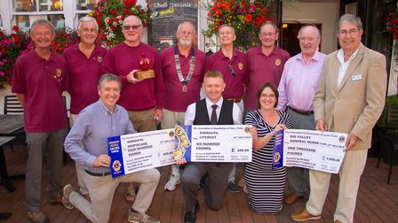 Sidmouth Lions with recipients cheques from the proceeds of the duck race. Ref shs 30 18TI 8718. Pic