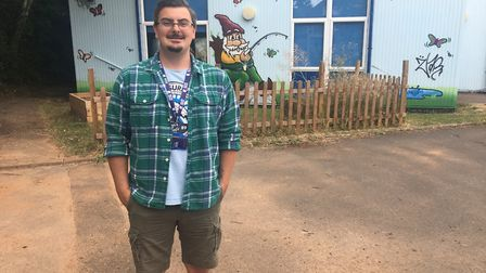 Youth Work Coordinator Ben Feasey outside the newly painted youth centre.