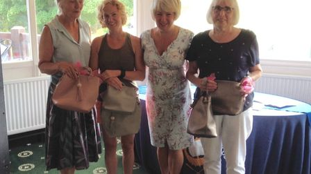 Sidmouth ladies captain Sheila Faulkner with the winners after her successful Captain's Day meeting.