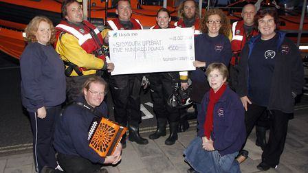 Sidmouth based folk group, the Sidmouth Steppers presented a cheque to the Sidmouth Lifeboat for £50