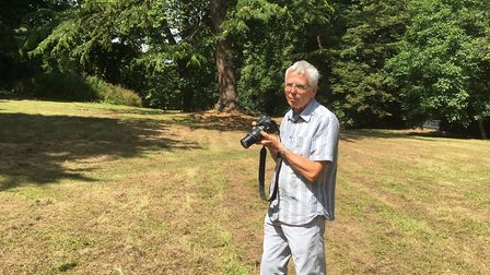 Ed Dolphin of Sidmouth Arboretum surveys the wildflower meadow mowed by accident
