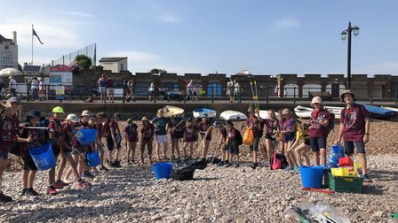 Leaders and the 27 strong group from 8th West Wickham in Kent do their bit while camping in Sidmouth