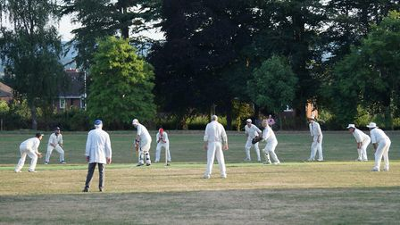 Tipton fielders surround the bat during the latter stages of the game at Exeter against Geriatrics.P