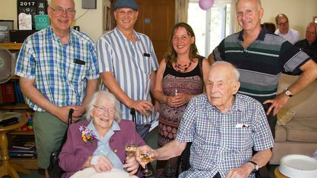 Jacquie Gilliam celebrates her 100th birthday with her husband and family. Ref shs 30 18TI 8507. Pic