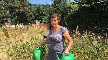 Allotment holder Ruth Rose in front of her old plot now untended