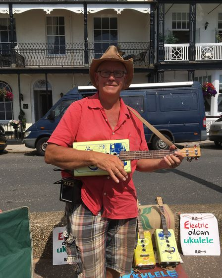 Ric Thorpe showcases his oil can electric ukuleles at Sidmouth FolkWeek. Picture: Clarissa Place