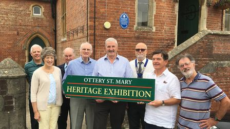 Members and trustees of Ottery Heritage Society with town councillors and the mayor outside their ne