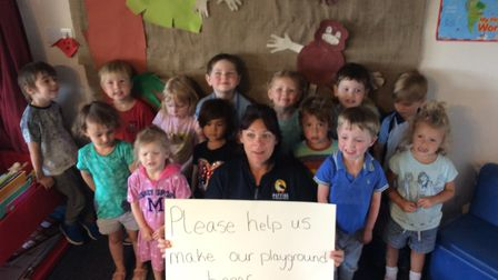 Pre-school assistant Hayley Cornell with children, appealing for support for their fundraising campa