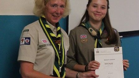 Sally Yeo, East Devon scout district commissioner, presented awards to members of the scout group an