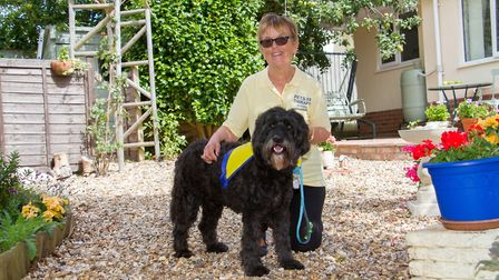 Pat Hague with Polly the therapy dog. Ref shs 32 18TI 9714. Picture: Terry Ife