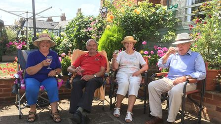 Di Lee, John Lee, Janet Crook, Ray Crook relaxing in the garden