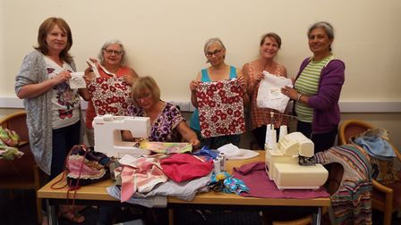 Members of the community with some of the boomerang bags they have made to try and reduce plastic in