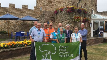 Councillors, East Devon District Council staff and volunteers proudly displaying the Green Flag Awar