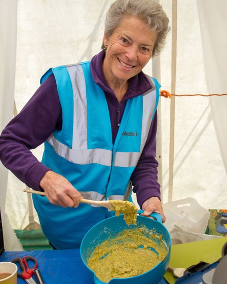 Lynette Talbot cooks up a dish at the Sidmouth Sea Fest. Ref shs 20-17TI 2923. Picture: Terry Ife