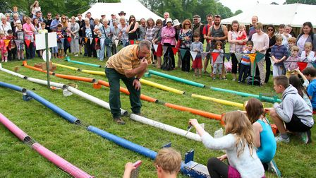 Cadhay May fayre. The whistle is blown for the ferret race to begin. Ref sho 22-16AW 8515. Picture: