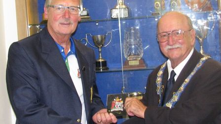 Ottery St Mary Bowls Club's Mike Smith being presented with his County Badge by Bowls Devon presiden