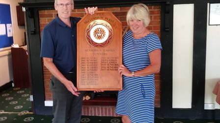 Sidmouth seniors captain Tony Stoyle handing over the Millenium Plate to lady captain Sheila Faulkne