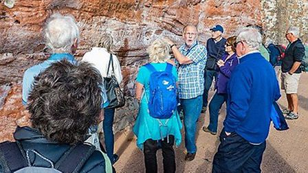 Geologist Dr Roger Trend leads a walk during Sidmouth Science Week in an earlier year. Picture: E Ma