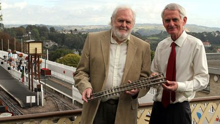 Bob Phelps with a piece of track designed by him during his 50 years service is pictured with employ