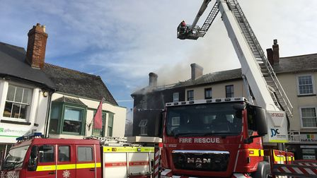 Six fire crews at the scene of blaze at Ottery Pine Shop. Picture: Clarissa Place
