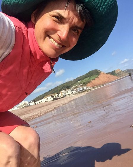 Alternative therapist Kati FitzHenry on Sidmouth beach. Picture: Contributed