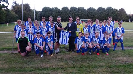 Ottery St Mary Under-12s and the handover of the new kit for this season.The kit sponsors are Exe Mo