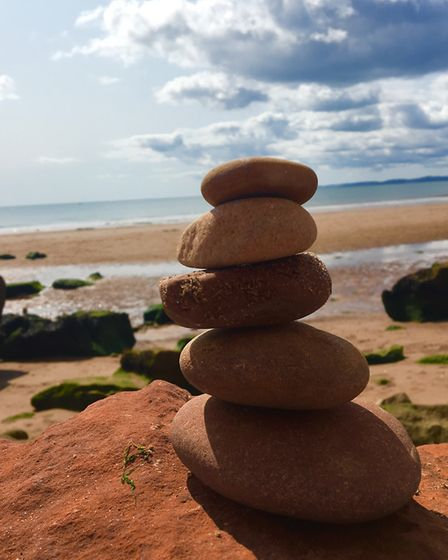 A beautiful day at Exmouth beach and made a beautiful pebble tower. Picture: Rowan O''Shaughnessy