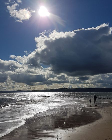 Father and son enjoying a stroll along Exmouth beach. Picture: James Luckock