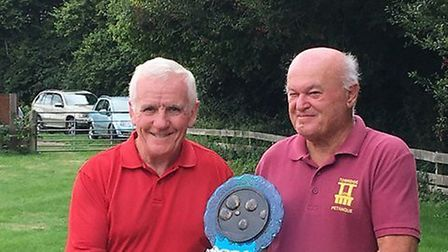 John Thatcher (left) is presented with the Devon Petanque singles title by Devon Petanque president