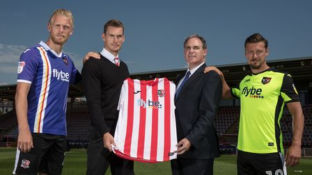 Matt Taylor, Manager of Exeter City with Flybe sponsors during the Exeter City Photocall at St James
