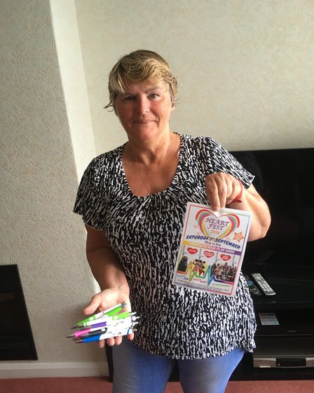 Marion Baker with the poster for her Heartfest fundraising event and promotional pens . Picture: Ph