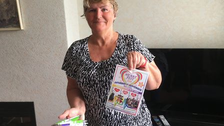 Marion Baker with her Heartfest photo and pens she sells to help raise money for the cause. Picture: