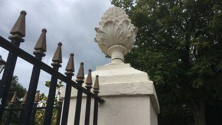 The stone pinapple which sits at the entrance of Blackmore Gardens and people fear may fall down. Pi