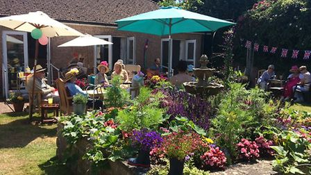 Ridgeway residents enjoyed entertaining party guests in their flower-filled garden. Picture: Contrib