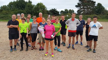 Kat Hall with the Sidmouth Rinning Club Monday runners. Picture; CONTRIBUTED