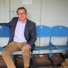 Mark Godfrey sits on theThe Wembley Bench at the Deer Park Country House.